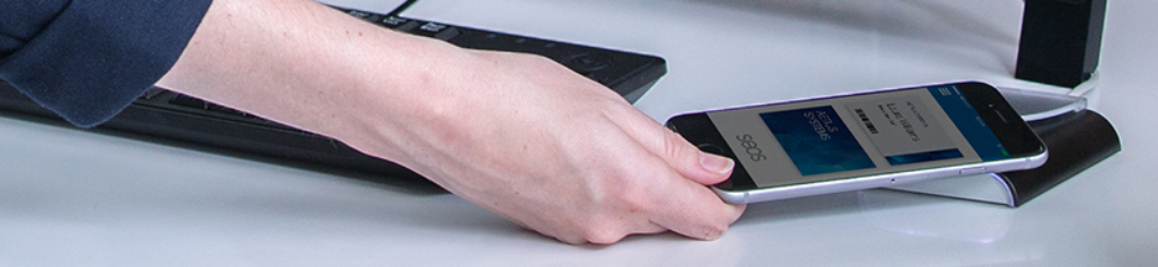woman tapping smart card on reader