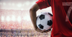man with a soccer ball in a stadium